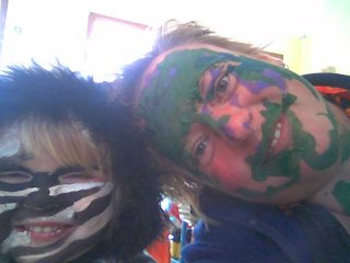 Hazel painted my face purple and green, I painted hers to match her zebra-print coat